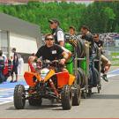 ATVs und Quads im Formel 1 Fahrerlager auf dem Red Bull Ring in Spielberg 2014: KTM als Zugmaschine im Rennsport-Einsatz