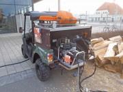 Kymco UXV 500: praktischer Träger von Holzspalt-Gerät mit 10 Meter langem Hydraulik-Schlauch