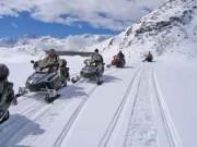 HB Adventure Switzerland: bietet Snowmobil-Touren in den Alpen im Januar in 'Action Packages' zu Sonderpreisen an